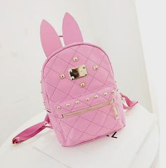 Material: PU Leather+Cotton Lining  Size: 20 cm by 28 cm by 10 cm (Measured by hand so there might be a 1-3 cm difference)  The rabbit ears can be taken off ^^