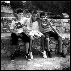 Thomas,Pantelis and Lefteris.8 years old.Best friends.Today was their first day at school.