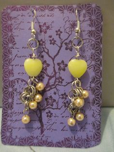 """yellow glass heart beads ;  silver chain / yellow pearls ;silver findings     2"""" long"""