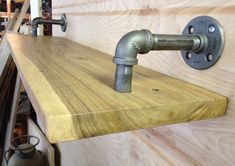 """Reclaimed Raw Edge Walnut Shelf with contemporary steel pipe brackets (34"""" length) on Etsy, $112.86 AUD Walnut Shelves, Pipe Shelves, Shelving, Wood Shelves, Building Furniture, Pipe Furniture, Industrial Furniture, Wood Slab, Raw Wood"""
