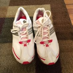 Adidas tennis shoes Adidas white and red tennis shoes. Barely worn. In great condition Adidas Shoes Athletic Shoes