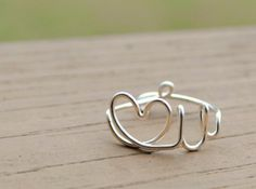"""Today's daily Etsy features the shop """"KissMeKrafty."""" This Etsy shop sells handcrafted wire wrapped rings and jewelry. Be sure to check out my favorite items from the store below!"""