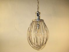 Wire Whisk Chandelier, would anyone buy this if I made them?? Such a cute kitchen light