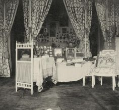 Imperial Bedroom. From Alexandra's upbringing you can see the British influence of  printed cottons and lace.  Also notice the Russian influence of multitudes of icons on the back walls.