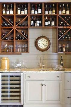 Wet bar w good wine storage. Needs: locking cab and ice maker.