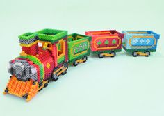 3D Holiday Train PDF Pattern : Create this festive Holiday Train to use as a colorful decoration this Christmas! Fill the cars with candies, ornaments, or tiny gifts for the ultimate effect.