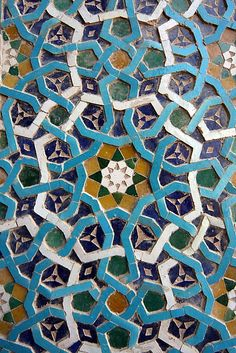Typical Islamic tile. These tiles are often hand made and painted rich in blues, reds and golds. They are used for a variety of different purposes such as decoration or hobbies.