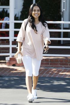 Karrueche TranWe're digging this powdery pink accent atop the white bottoms. #refinery29 http://www.refinery29.com/2016/10/124865/taylor-swift-celebrity-leggings-outfits#slide-18