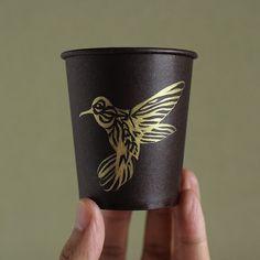 A hummingbird painted on a paper cup. #illustration #drawing #sketch #design #artcraft #art #papercup #hummingbird #gold #gouache