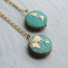 This beautiful locket is vintage brass, which has been carefully hand enamelled to turn the sea into a beautiful milky turquoise colour. The turquoise looks amazing with the golden brass!  Choose from a single-sided locket with either the Eastern or Western hemisphere on the front - or you can choose to have both sides of the locket decorated, with the East on one side and West on the other. The locket is one inch across and there is space inside for two pictures or photographs. It has a…