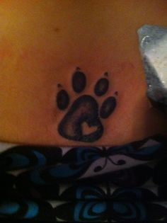 Pawprint with heart tattoo in memory of our lost furry friends.