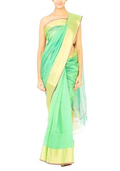 In a colour that never fails to please, we bring to you a Coorv saree crafted from green silk cotton fabric. The Maheshwar saree features a green body with a golden border and tassels in the pallu that lend it extravagance. Given its colour, the saree will look great with both gold and antique jewellery.