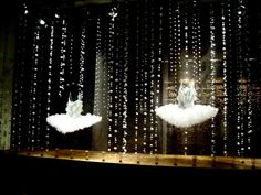 Glass beads or lights hung vertically from floor to ceiling, with two simple dance costumes. Makes a great window display.