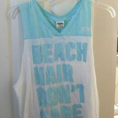 Victoria's Secret Pink Muscle Tee Sz M Victoria's Secret Pink muscle tee. White with light blue lettering: beach hair I don't care. Never worn. Washed and hung dry. Super cute! Great for gym for beach or for whatever! PINK Victoria's Secret Tops Muscle Tees