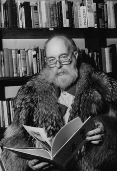 Edward Gorey in his library