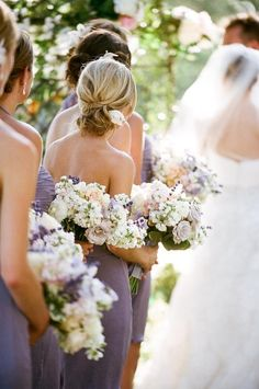 Here are some stunning bouquets with hints of lilac and the bridesmaids are wearing a lovely dusty purple coloured dress.