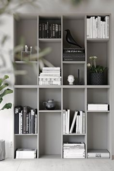 IKEA bookcase hack using 2 VALJE shelf units flipped 90° and grey painted