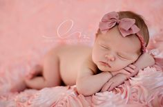 Love the fabric under this sweet baby! Id love a portrait like this!