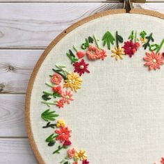 Round Floral Embroidery Hoop - Mothers day gift - Hoop Art - Wall Art - Home Decor - Wall Hanging Whether you hang this round floral embroidery hoop right on the wall, or prop it up on a bookcase, it will look absolutely gorgeous! Made with embroidery thread and sewn on white fabric, the