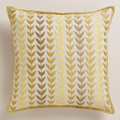 Triangle geometric prints in soft hues make this exclusive throw pillow a modern addition to any room. With a slight sheen in the thread and yellow and green piping, it's an affordable way to add instant luxe to a sofa or daybed.
