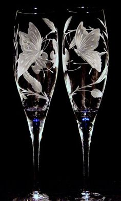Hand Engraved Crystal Stemware by Catherine Miller of Catherine Miller Designs*Technique-Stone wheel*Stems created by Orrefors * Butterflies & Flowers