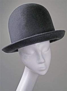 This is a grey large round hat that is made by Prudence Millinery. 56fd66030e95