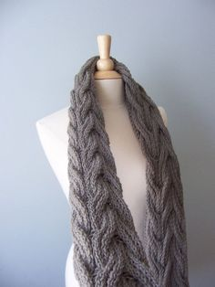 The is a reversible cabled wrap of my own design. Which means that no matter how you put it on the cable will look beautiful. Warm but yet a versatile piece. It can be worn as a wrap, a shawl or a a scarf. A classic that will surely hold the test of time. You will need to know how to