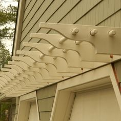 A DIY pergola adds architectural interest to this garage.  See the full effect here. | thisoldhouse.com/yourTOH