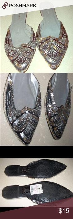 "Kenneth Cole Reaction Mule 'Taj' Women's pre-owned REACTION KENNETH COLE ""Taj"" slip on flats.  Worn once or twice. Black shoe with silver sequins   Size 7.5 Kenneth Cole Reaction Shoes Mules & Clogs"