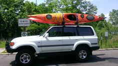 1997 Toyota Land Cruiser 80 Series Wilderness Systems Tsunami kayaks w/rudder Land Cruiser 80, Toyota Land Cruiser, Wilderness Systems, Kayaks, Tsunami, Vehicles, Tsunami Waves, Car, Kayaking