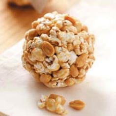 Peanutty Popcorn Balls -m•2 cups popped popcorn  •1/2 cup salted peanuts  •2 tablespoons brown sugar  •2 tablespoons light corn syrup  •1 tablespoon creamy peanut butter  •Dash salt