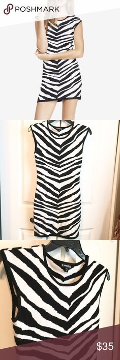 🚨FINAL PRICE SALE🚨 Express Tiger Striped Dress Embrace your wild side with this super comfortable and sexy tiger striped dress🐯 Fits snug to the body and made of a soft, stretchy material. Gently used. Express Dresses Mini