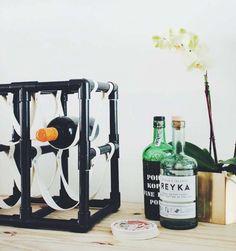 DIY pipe and leather wine rack from Design*Sponge.