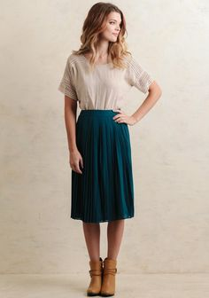 Flirty and fun, this gorgeous teal-hued midi skirt features an allover pleated design perfect for adding some extra feminine flair to any ensemble. Finished with a hidden back zipper and single-b...