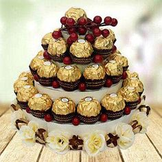 On this special day, cut a cake in style. Make the lucky recipient feel special with a unique gift of 3 tier Ferrero Rocher chocolate tower.  #3TierFerreroRocherCake    #TemptingChocolateCake  #BirthdayCakes