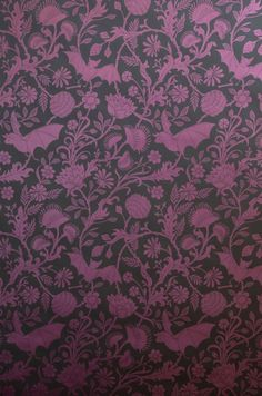 Elysian Fields is a dense, intricate floral that utilizes carnivorous plants and bats instead of roses and robins. We love the irreverence of these unexpected elements within the classic stylings of the pattern work. Chose Antique Pink on Oatmeal for a soft traditional look or Licorice for some serious edge.