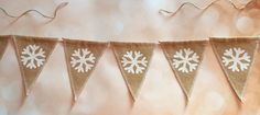 A personal favorite from my Etsy shop https://www.etsy.com/listing/241368115/snowflakes-natural-burlap-banner-holiday