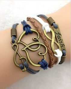 Faith, Infinity Hearts, Music Note ModWrap in blue, brown, white - http://www.gomodestly.com/product/faith-infinity-hearts-music-note-wrap-bracelet-multi-color/