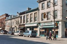 King St. & Princess St., Kingston, Ontario. Kingston, Ontario is a Canadian city located in Eastern Ontario where the St. Lawrence River flows out of Lake Ontario. Originally a First Nations settlement, growing European exploration in the 17th Century made it an important trading post. In order to control the fur trade, French explorer LaSalle founded Fort Frontenac in 1673. Located midway between Toronto and Montreal, Kingston was named the first capital of the Province of Canada.