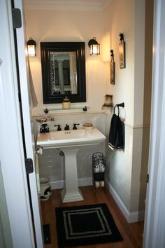 Wood Molding Or Dark Color On Bottom Instead Of Tile, Like The Carriage  Lights (electrical Would Have To Be Adjusted), Really Nice Sink