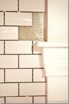 How to install white subway tile backsplash. This is what I really (think) I want in the kitchen =) (And it tells you how to take off the annoying partial backsplash made of counter material!)