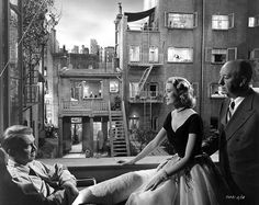 Jimmy Stewart, Grace Kelly and Alfred Hitchcock on the set of Rear Window