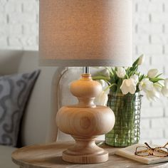Goodall Table Lamp | The rounded wooden curves of this handsome table lamp lend an air of warmth and charm. Topped with a coordinating beige linen shade.