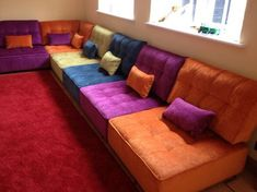 Bright and cheerful for a playroom/nursery - practical too as they convert quickly into sofa bedding for occasional use. Living Room Seating, Living Room Sofa, Living Room Decor, Luxury Sofa, Luxury Bedding, Multipurpose Guest Room, Best Futon, Sofa Design, Interior Design