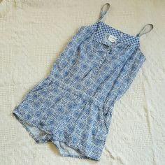 Adorable H&M romper. Lightweight, summer romper with pockets. Such a cute outfit!! Length from shoulder to bottom of shorts is 27 inches. Smoke free home. H&M Dresses Mini