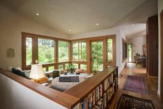 Half wall for sunken living room, lots of wood and natural light. 450 Architects, Inc.