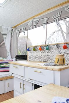 This camper is full of DIY projects - you'd never believe how it looked before. Pop up camper remodel with an eclectic vintage boho feel via Refresh Living. #traveltrailers