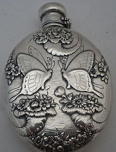 Tiffany & Co sterling silver flask with a butterfly motif, c1885