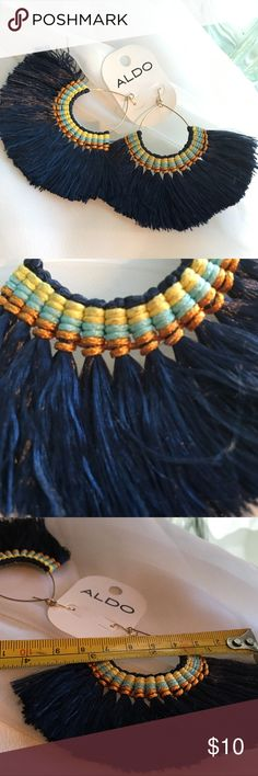 Aldo Tribal Style Earrings NWT Playful and polished, tribal style earrings are perfect for day or night. At jaw dropping size fun tassels dance with your every move.  Never been worn.  Original price 12.00.  Make me an offer! Aldo Jewelry Earrings