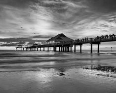 This is a photo of the sunset at a pier in Clearwater Beach, Florida. The image is printed on professional, acid free, archival satin paper giving